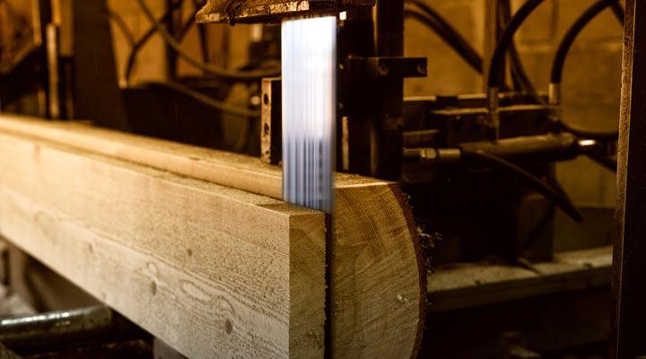sharp saw cutting wood board from log