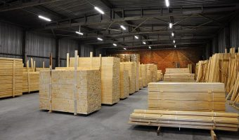 warehouse with stacks of fresh wood boards